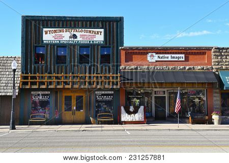 CODY, WYOMING - JUNE 24, 2017: Wyoming Buffalo Company and Native Images are two shops on Sheridan Avenue in Cody, Wyoming.