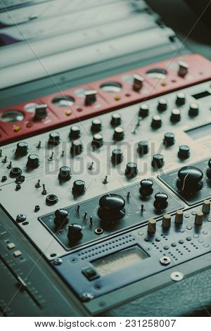 Close-up Shot Of Graphic Equalizer With Various Knobs At Recording Studio