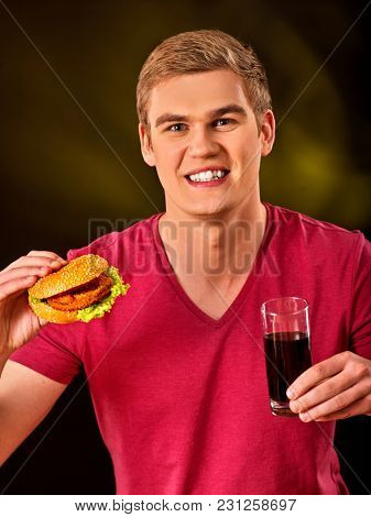 Man eating pizza and drink . Student consume fast food. Male trying to eat a of junk. Advertise fast food on black background.