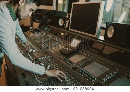 Concentrated African American Sound Producer Working With Graphic Equalizer