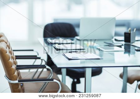 Closeup Of A Desk With The Documents Prepared By The Beginning Of Business Negotiation.the Photo Has