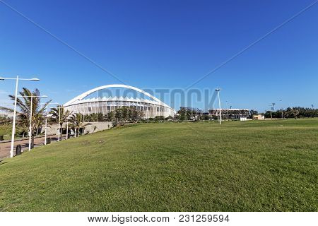 Grass Lawn Recreational Area Against Moses Mabhida Stadium