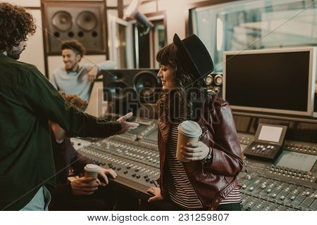 Group Of Young Musicians Spending Time At Recording Studio