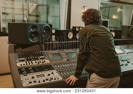 Young Sound Producer Working At Recording Studio