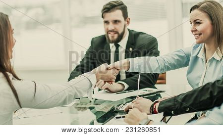 Handshake Business Partners After Discussing The Terms Of A New Contract In The Workplace In A Moder