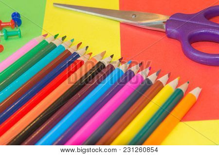 Many Colored Pencils On Colored Background. Art Of Color Pencils As Wallpaper. Variety Of Color