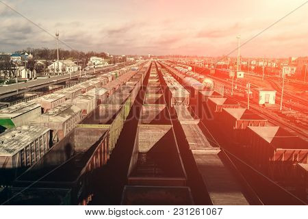 A Lot Of Freight Rail Cars, A Cargo Distribution Station. Staging Post. Large Parking Of Trains.