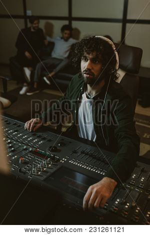 View Of Concentrated Sound Producer Working At Studio
