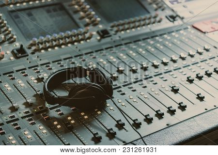Headphones On Graphic Equalizer At Recording Studio