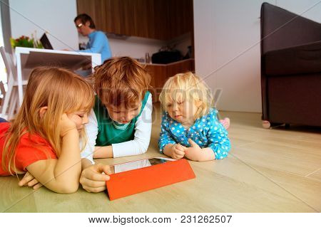 Father Works From Home While Kids Watch Touch Pad, Remote Home Work