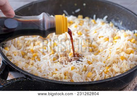 Preparation Of Fried Rice With Egg In Frying Pan. Fried Rice