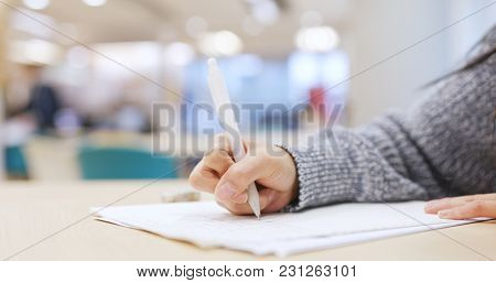Student taking note on paper
