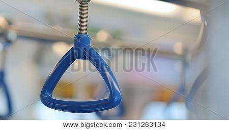 Hand rail inside train compartment