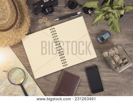 Notebook Planning Vacation With Map And Accessories. Concept Travel Background.