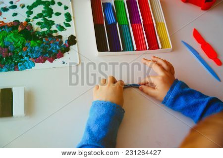 Child Playing With Clay Molding Shapes, Education And Learning