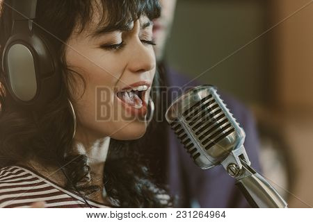 View Of Sensual Young Female Singer Performing Song