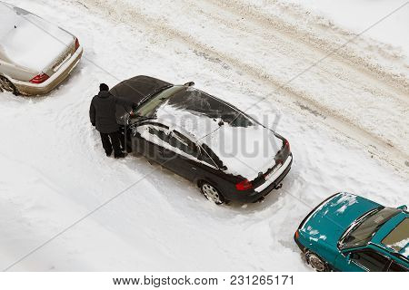 Gomel, Belarus - March 3, 2018: Cars Parked Near Residential Multi-storey Houses Covered With Snow.