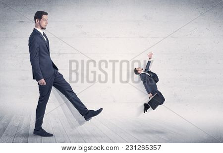 Giant man kicking out small man from space with grungy background