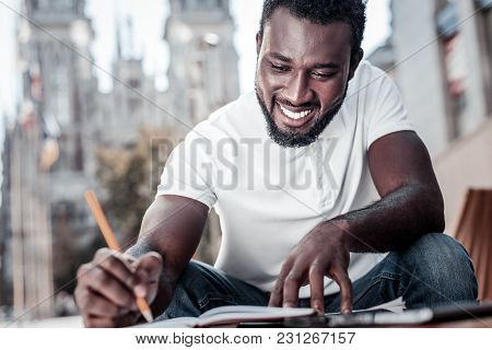 No Time For Worries. Low Angle Shot Of A Positive Minded African American Man Grinning Broadly While