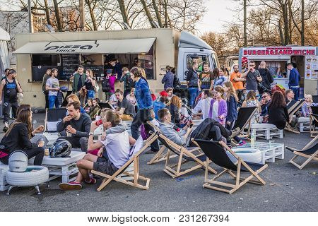 Warsaw, Poland - April 1, 2017: People In Front Of Food Trucks With Pizza And Burgers During Food Tr