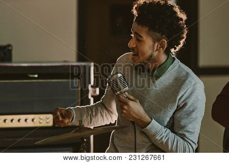 Handsome African American Singer Performing Song With Microphone