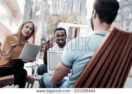 Teamwork Makes The Dreamwork. Group Of Smart Millennial People Sitting Outdoors With Their Laptops O
