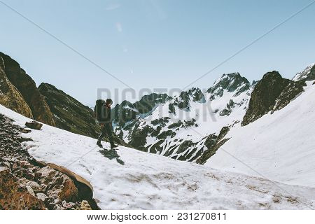 Man Traveler With Backpack Hiking In Snowy Mountains Travel Survival Lifestyle Concept Adventure Out