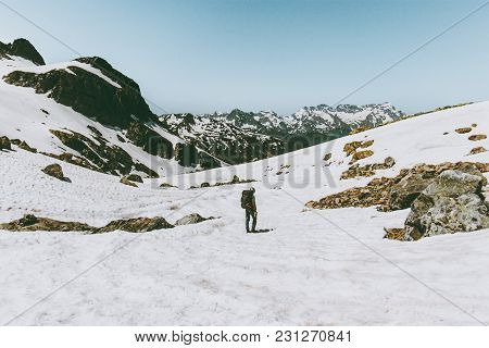 Man Hiking In Snowy Mountains Travel Lifestyle Survival Concept Adventure Outdoor Wanderlust Vacatio