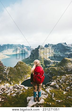 Backpacker Woman Standing Alone In Mountains Norway Traveling Healthy Lifestyle Adventure Concept Su