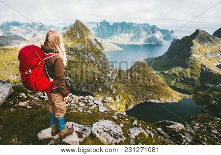 Traveler Woman With Red Backpack Hiking In Mountains Of Norway Traveling Healthy Lifestyle Adventure