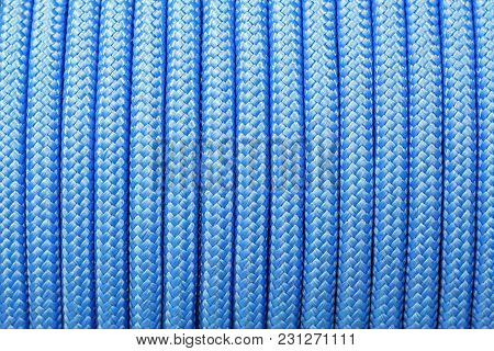 Blue Background Of A Synthetic Rope On A Babin
