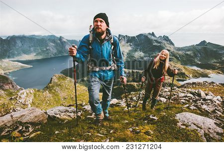 Couple Travelers Hiking In Mountains Family Traveling Together Adventure Lifestyle Concept Vacations