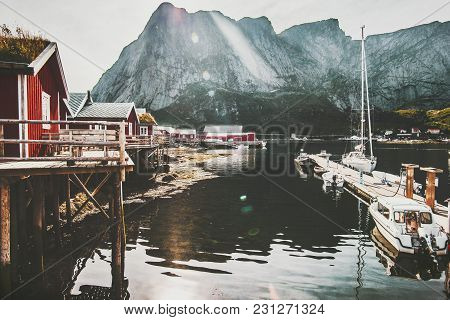 Reine Village In Norway Traditional Rorbu Red Houses At Sea And Rocky Mountains View Travel Scenery