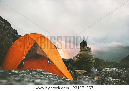 Man Traveler Relaxing In Mountains Near Of Tent Camping Gear Outdoor Travel Adventure Lifestyle Conc