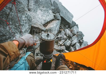 Man Traveler Cooking Food In Pot On Stove Burner In Camping Tent Travel Lifestyle Concept Vacations