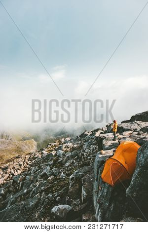 Camping Tent On The Top Of Mountain Rocky Cliff And Traveler Enjoying Landscape Aerial View Adventur