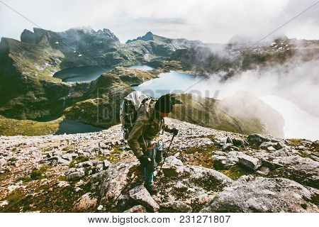 Backpacker Man Hiking In Mountains  Norway Travel Adventure Lifestyle Concept Hiking Active Wanderlu