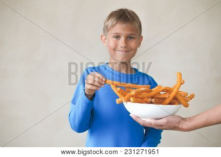 Child Eating Popular Sweat Spanish Dessert Churros.