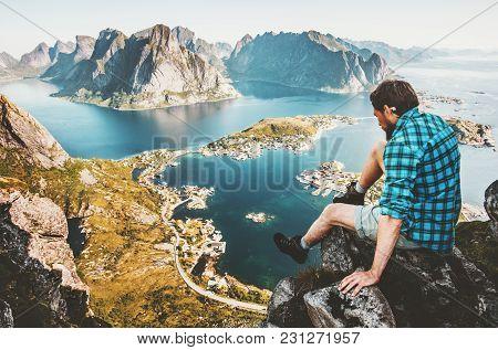 Travel Man Sitting On Cliff Edge In Norway Lifestyle Adventure Outdoor Summer Vacations Reinebringen