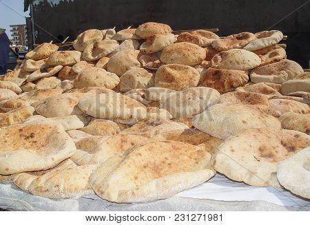 Arabic Bread Lying On The Table. Egypt