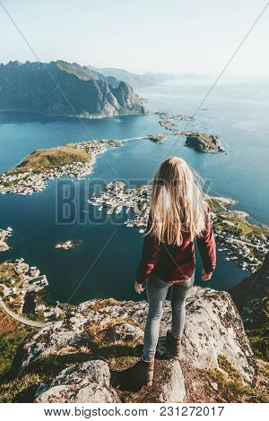 Young Woman In Norway Standing Alone On Cliff  Mountain Lifestyle Exploring Concept Adventure Outdoo