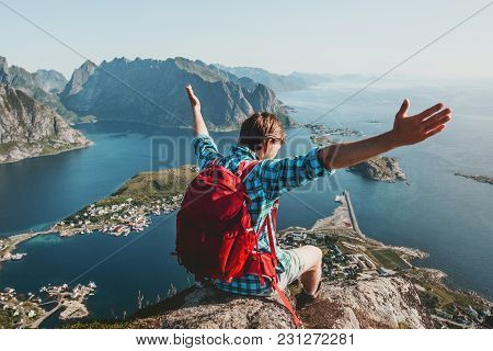 Happy Man Raised Hands Traveling In Norway Sitting On Cliff Edge Lifestyle Adventure Outdoor Summer