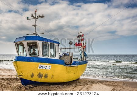 Rewal, Poland - May 11, 2017: Fishing Boat On A Beach In Rewal Village Over Baltic Sea In West Pomer