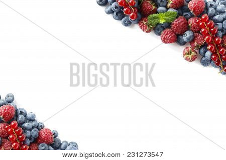 Mix Berries And Fruits On A White. Berries And Fruits At Border Of Image With Copy Space For Text. R