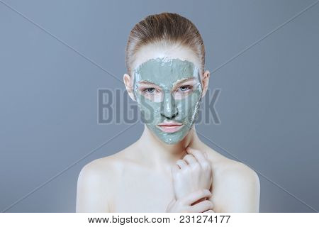 Beautiful spa woman in facial mask. Beauty, natural cosmetics concept. Spa, body care.