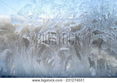 Patterned Frost On The Window Glass In The Winter