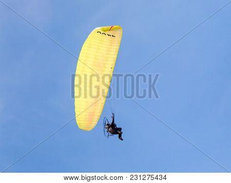 Caesarea, Israel, March 03, 2018 :  The Sportsman On A Color Motorized Parachute Flies In The Clear