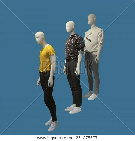 Three Man Mannequins Dressed In Clothes, Isolated. No Brand Names Or Copyright Objects.