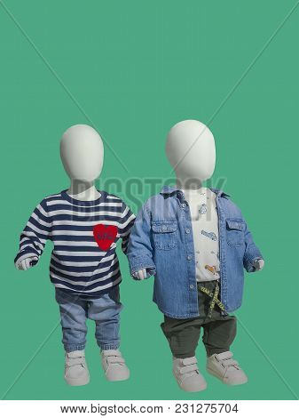 Two Children Mannequins Dressed In A Fall Style, Isolated. No Brand Names Or Copyright Objects.