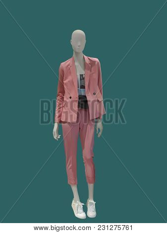 Full-length Female Mannequin Dressed In Fashionable Pink Trouser Suit, Isolated. No Brand Names Or C